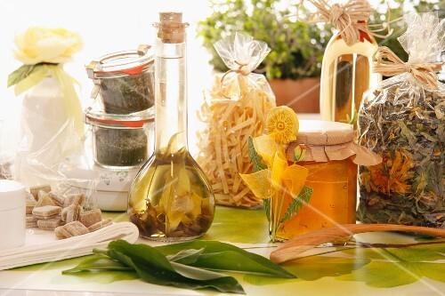An arrangement of herb vinegar and dandelion honey