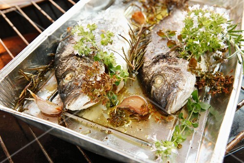 Oven-baked bream with herbs and garlic