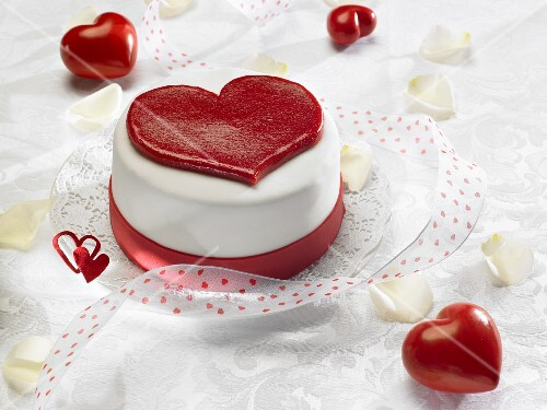 """The Word """"Love"""" on Heart Shaped Cake"""