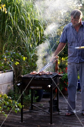 A man barbecuing on a terrace