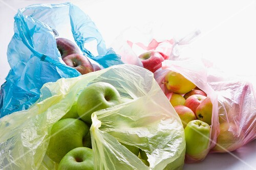 Various types of apples in a plastic bag