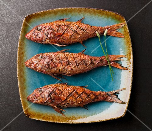 Three Whole Grilled Red Mullet Fish on a Platter