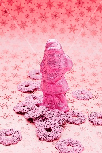 A pink Father Christmas and fondant rings