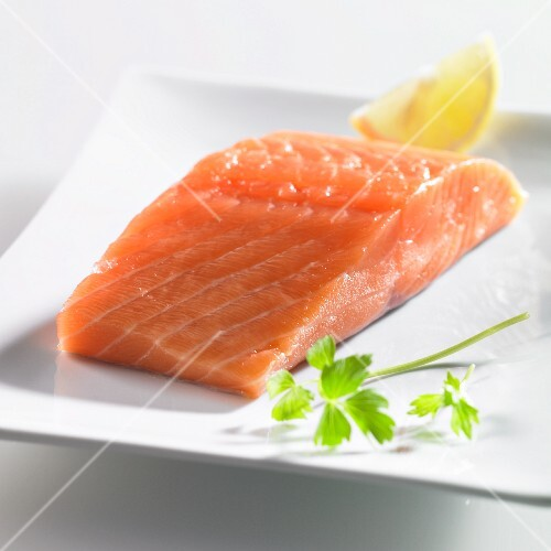 Fresh salmon fillet with parsley and lemon