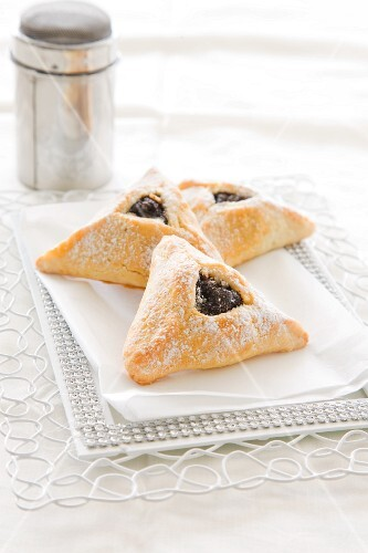Hamantashen filled with poppyseeds, apples and almonds