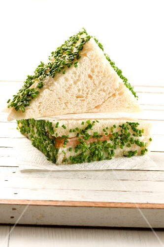 A salmon sandwich with chives