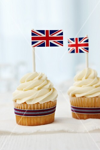 Vanilla cupcakes topped with cream cheese frosting and British flags