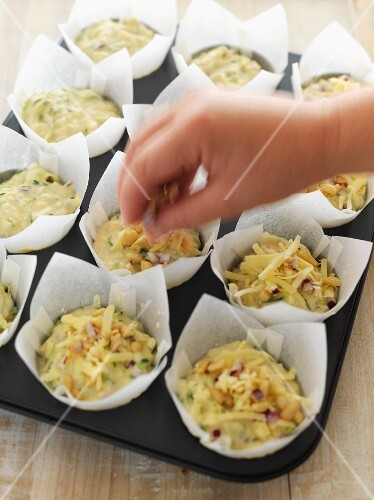 Courgette and cheese muffins being prepared