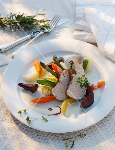 Veal on a bed of vegetables with a wine sauce