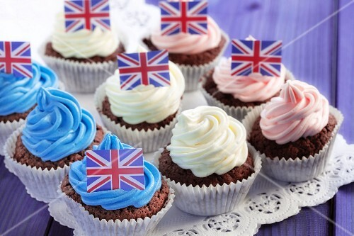 Chocolate cupcakes decorated with coloured cream and Union Jacks