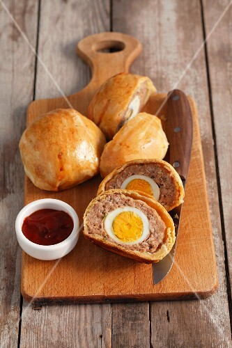 Scotch eggs with ketchup