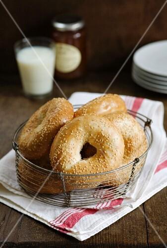 Sesame seed bagels in a bread basket