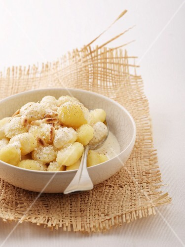 Gnocci with a creamy cheese sauce and roasted pine nuts