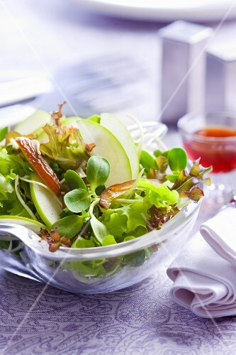 A salad with apple wedges, kohlrabi and dates