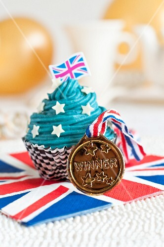 A cupcake decorated with a Union Jack and a medal
