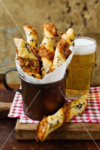 Cheese breadsticks and a glass of beer