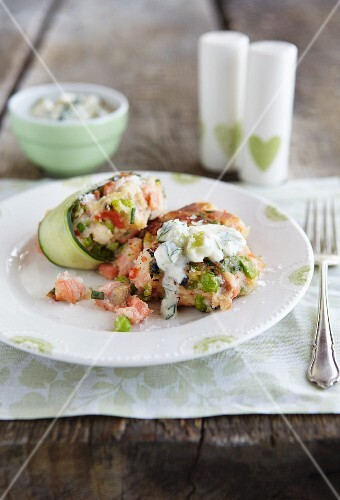 Salmon cakes with a warm cucumber salad