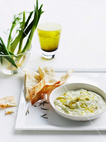 Artichoke dip with crispy rosemary bread