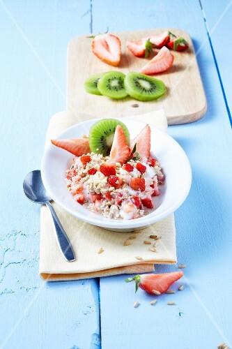 Muesli with fresh strawberries and kiwi