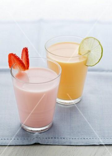 A strawberry milkshake and a mango lassi (mango yogurt drink)