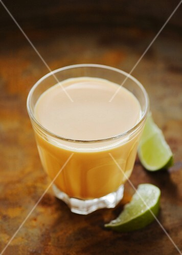 A glass of mango lassi (mango yogurt drink)