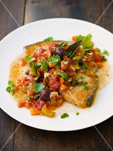 Swordfish with a tomato and olive medley