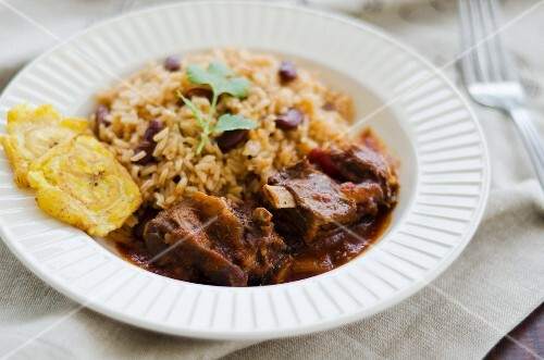 Goat ragout with beans and rice and tostones (Jamaica)