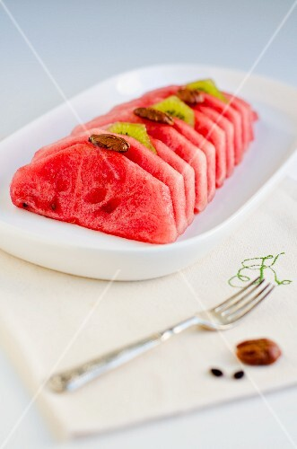Watermelon slices with kiwis and pecan nuts
