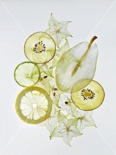 Various sliced fruits (pear, kiwi, lemon, star fruit)