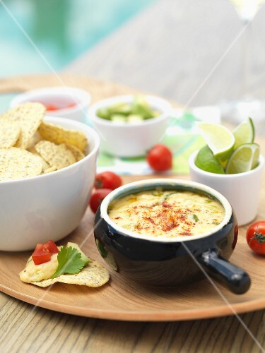 A warm cheese dip with tortilla chips