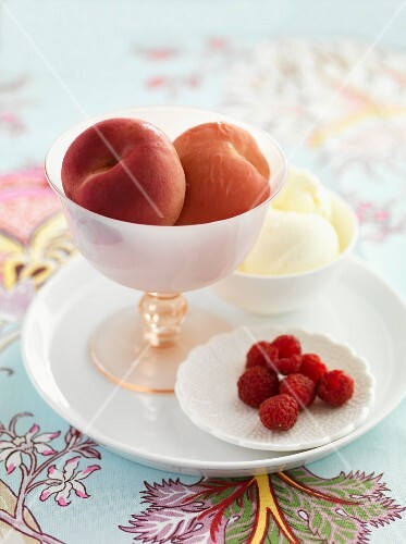 Peaches poached in rose water with raspberry and vanilla ice cream