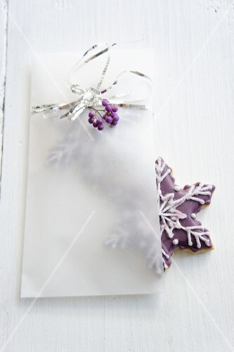 Snowflake-shaped biscuits in a paper bag