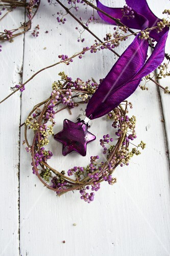 Wreath of beautyberry with purple, glass, star-shaped bauble