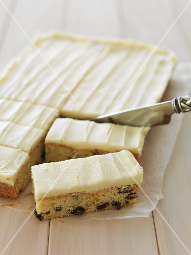 Tray bake raisin cake with icing