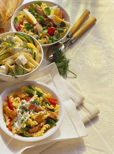 Three different pasta salads in bowls