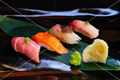 A sushi platter with wasabi and ginger