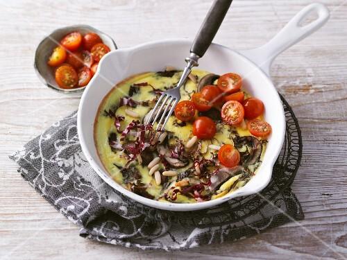 Mushroom and radicchio frittata served with cherry tomatoes