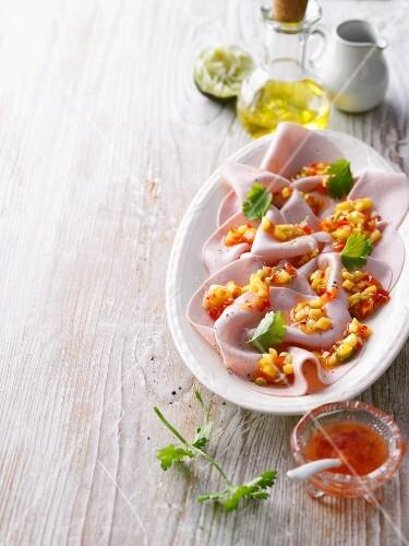Turkey breast carpaccio with mango and pepper salsa
