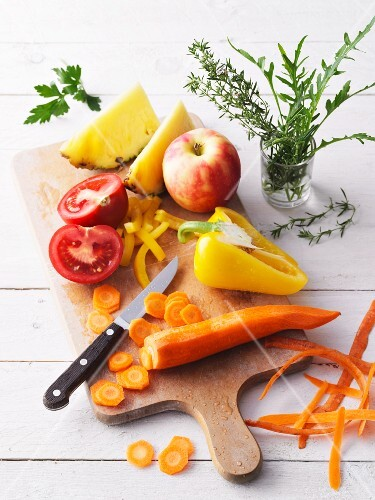 Sliced fresh fruit and vegetables on a chopping board