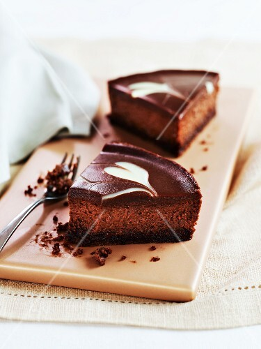 Two slices of Belgian chocolate cheesecake