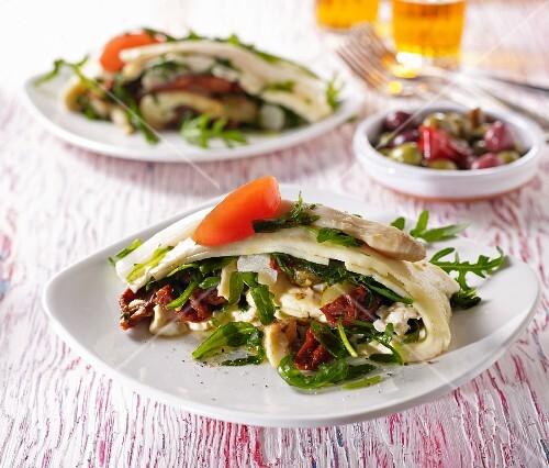 Mozzarella farcita: mozzarella rolls filled with tomatoes, olives, asparagus and rocket