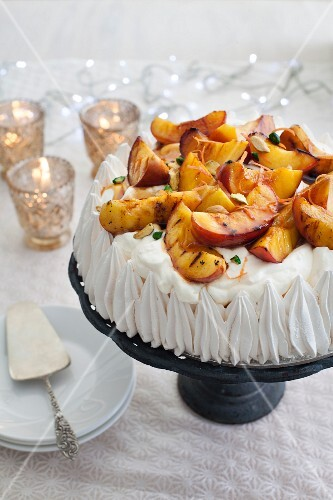 Peach and pistachio pavlova