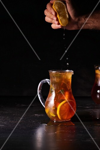 Lemon juice being added to iced tea