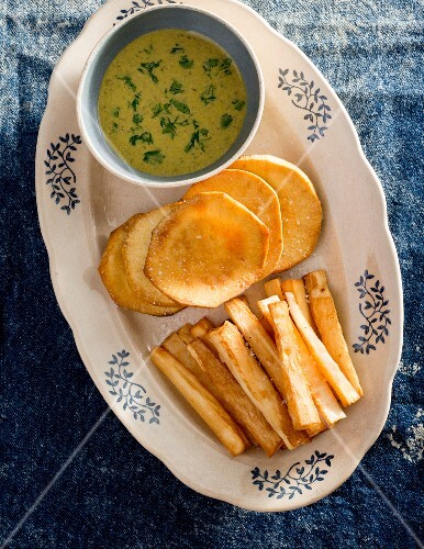 Fried cassava and sweet potatoes with a dip (Caribbean)