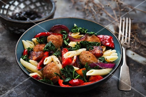 Pasta salad with meat balls, grilled peppers and savoy cabbage