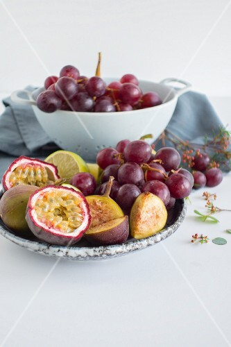 A fruit bowl with grapes, figs and passion fruit