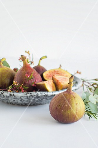 Figs on a marble plate and in front of it