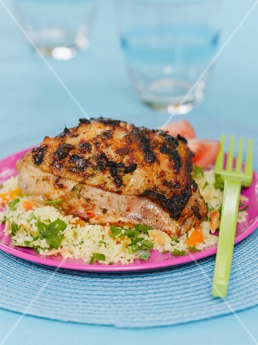 Grilled chicken served with couscous