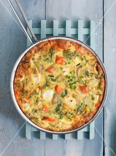 A salmon frittata in a pan (seen from above)