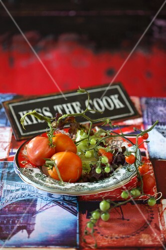 Various red and green tomatoes on a plate